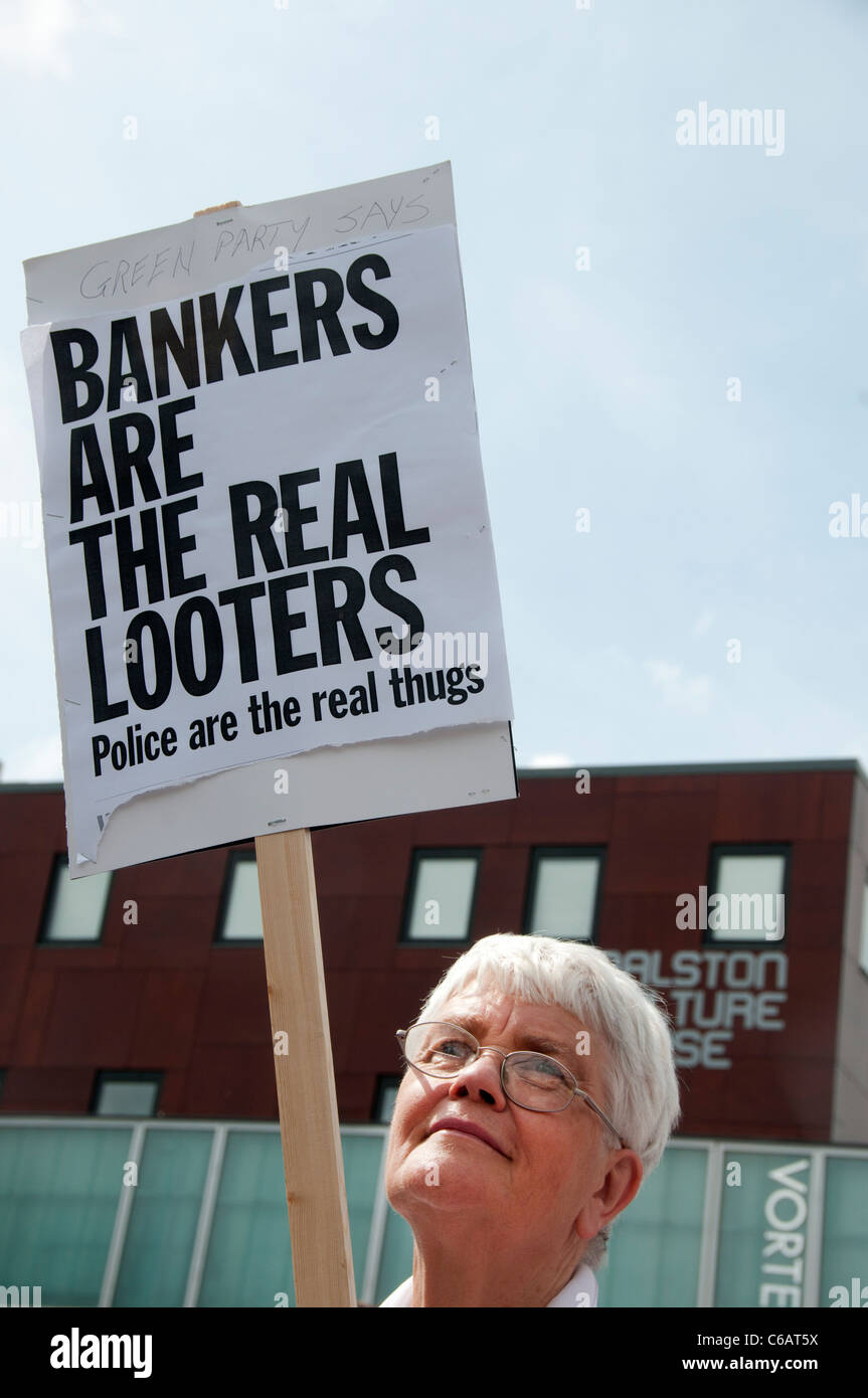 Peace march after the riots, Hackney. Middle-aged woman with placard saying bankers are real looters - Stock Image