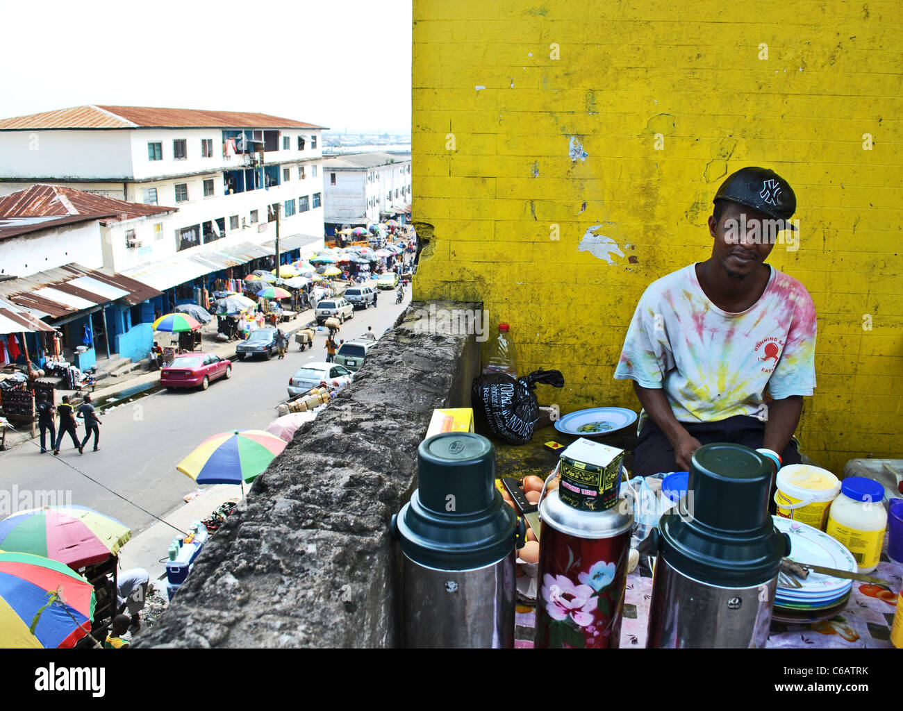Colourful portrait of a coffee seller in downtown Monrovia, Liberia, West Africa - Stock Image