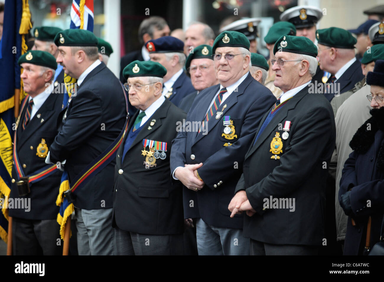 Royal Marines veterans amongst mourners gathered for a repatriation ceremony at Wootton Bassett, Wiltshire UK Dec Stock Photo