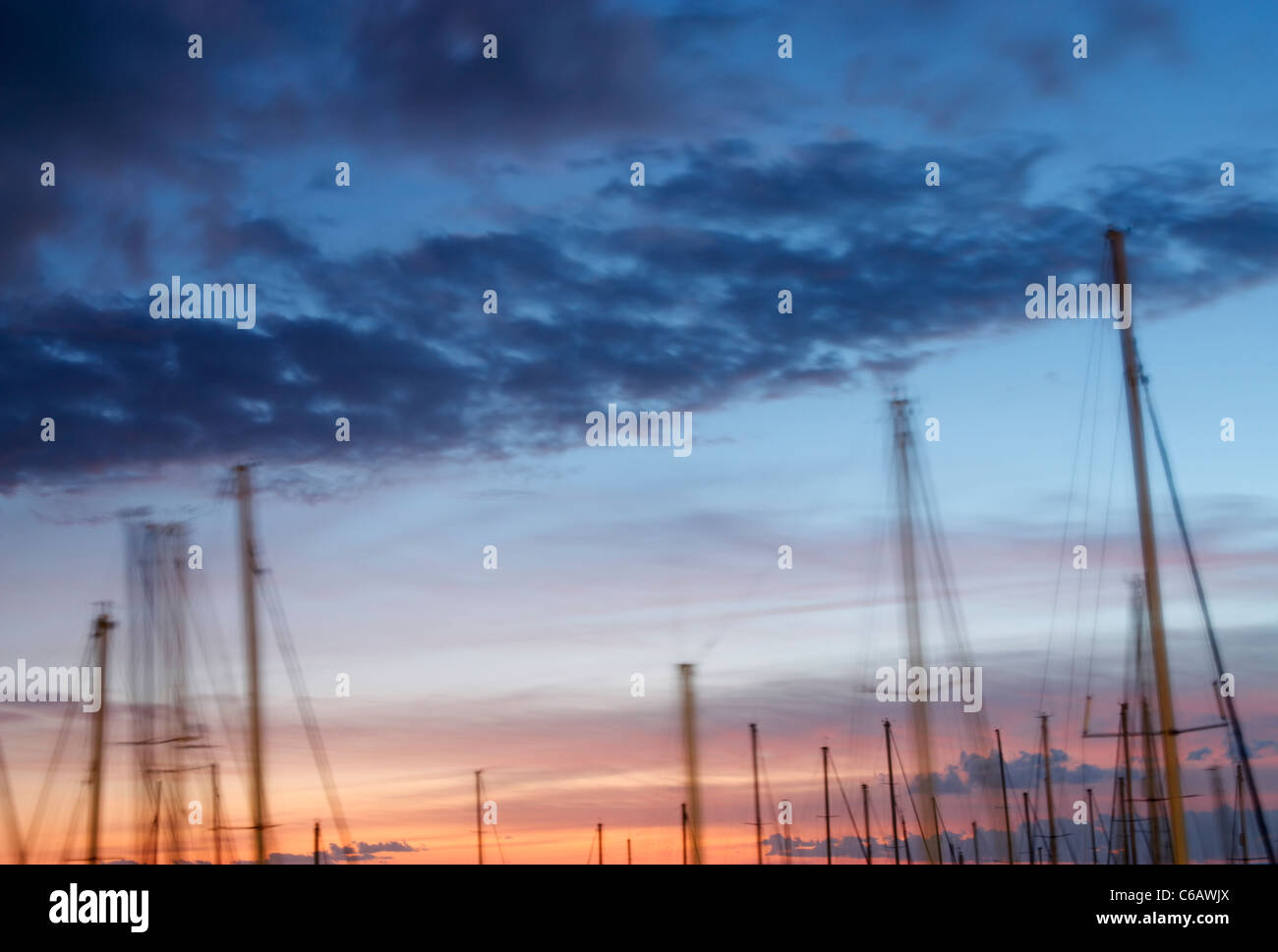 Yacht masts at sunset - Stock Image