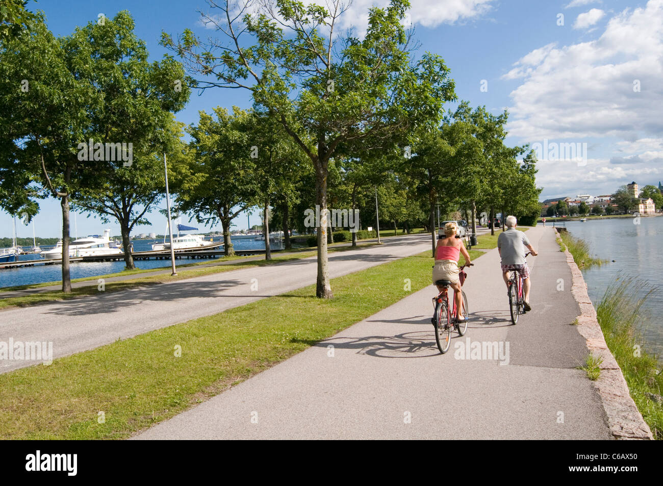 Västervik sweden swedish town cycle path paths cyclepath cyclepaths bike cycle cycling ride riders path paths - Stock Image