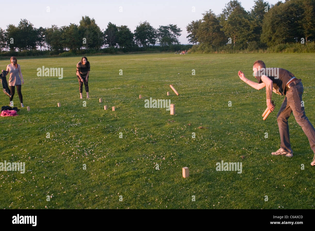 Kubb sweden swedish game games traditional people play playing players outdoor bowling horseshoes skill tactics - Stock Image