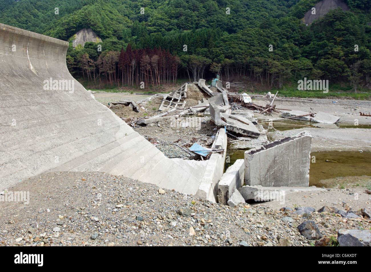 A tsunami wall or barrier in Iwate – the tsunami simply breached it, and then tore it to piece (the sea is on the - Stock Image