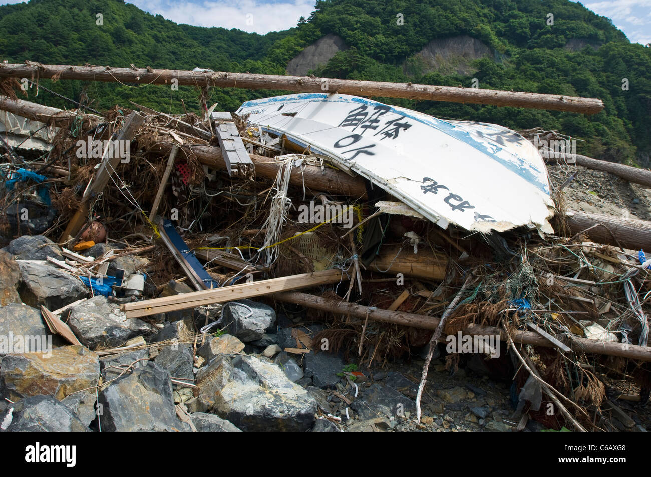 Tsunami debris waiting to be cleared - Stock Image