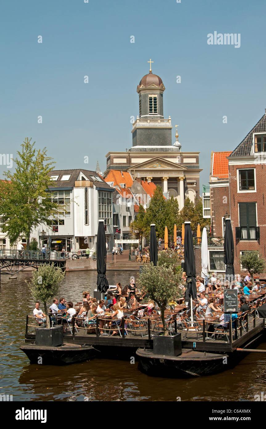 Hartebrugkerk Leiden Rhine Netherlands boat bar pub pavement Oude Rijn Old Rhine - Stock Image