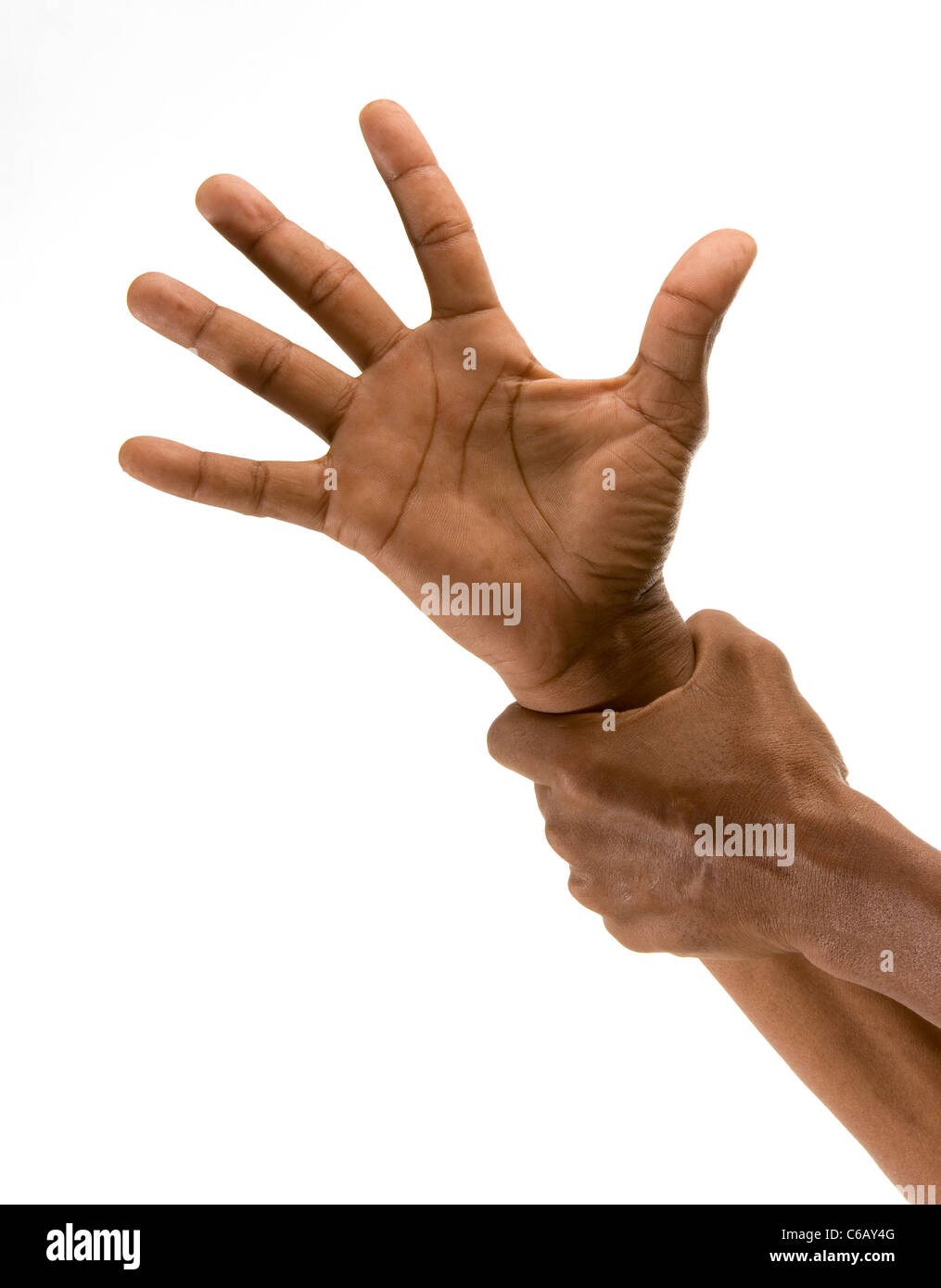 African's outstretched hand being gripped at the wrist by another hand. . Studio shot on white background. - Stock Image