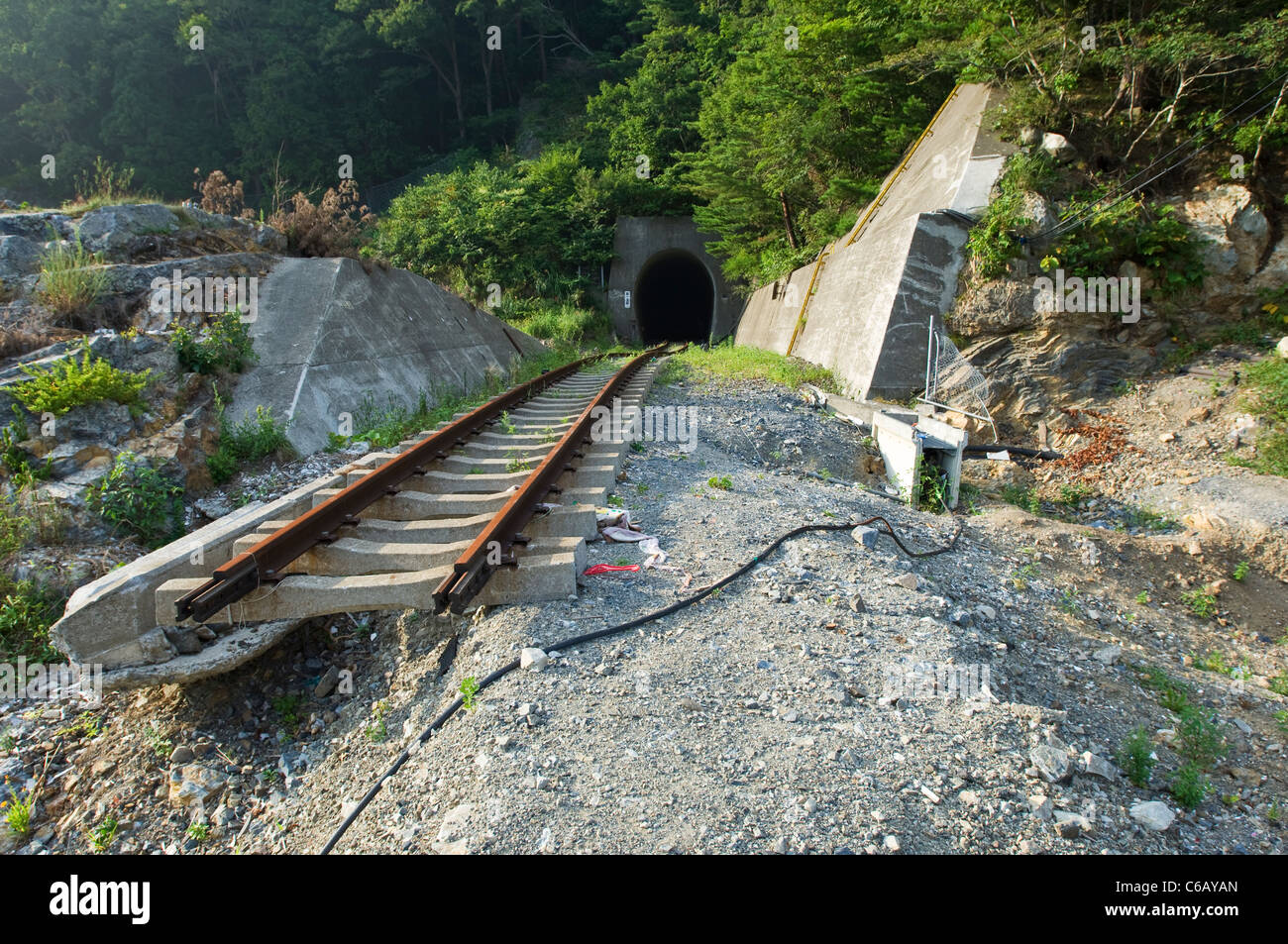 Railway tracks shifted by the force of a tsunami - Stock Image