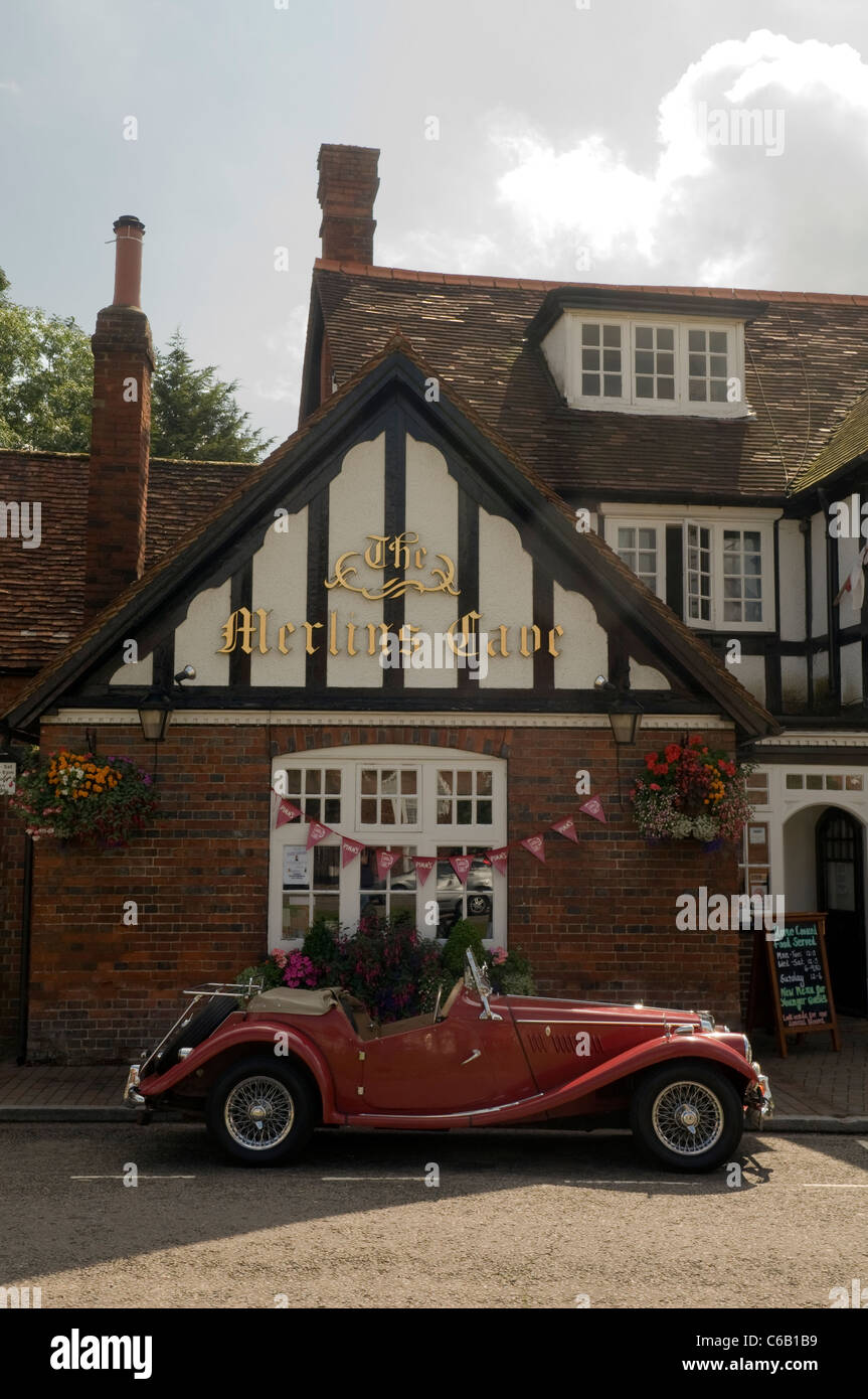 a vintage classic red MG car parked outside the the Merlin's Cave pub Chalfont St Giles Bucks UK - Stock Image