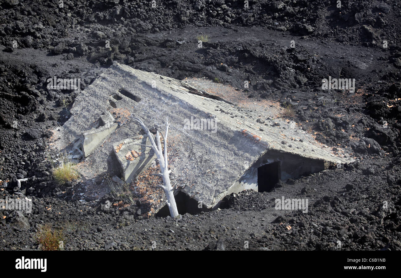 House after a volcanic eruption - Stock Image