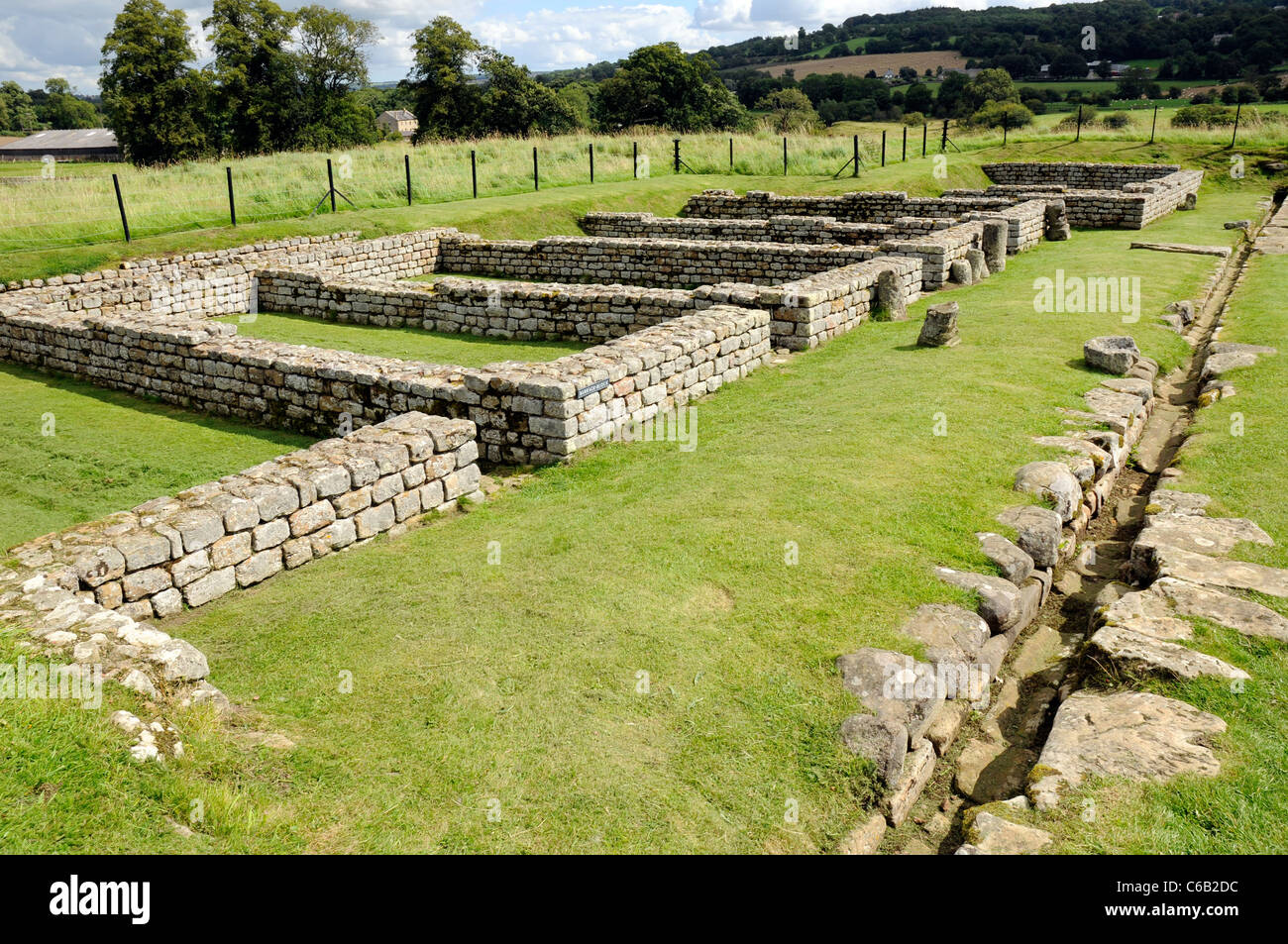 Roman barracks (ruins) at Chesters Fort, on Hadrian's Wall, England. - Stock Image