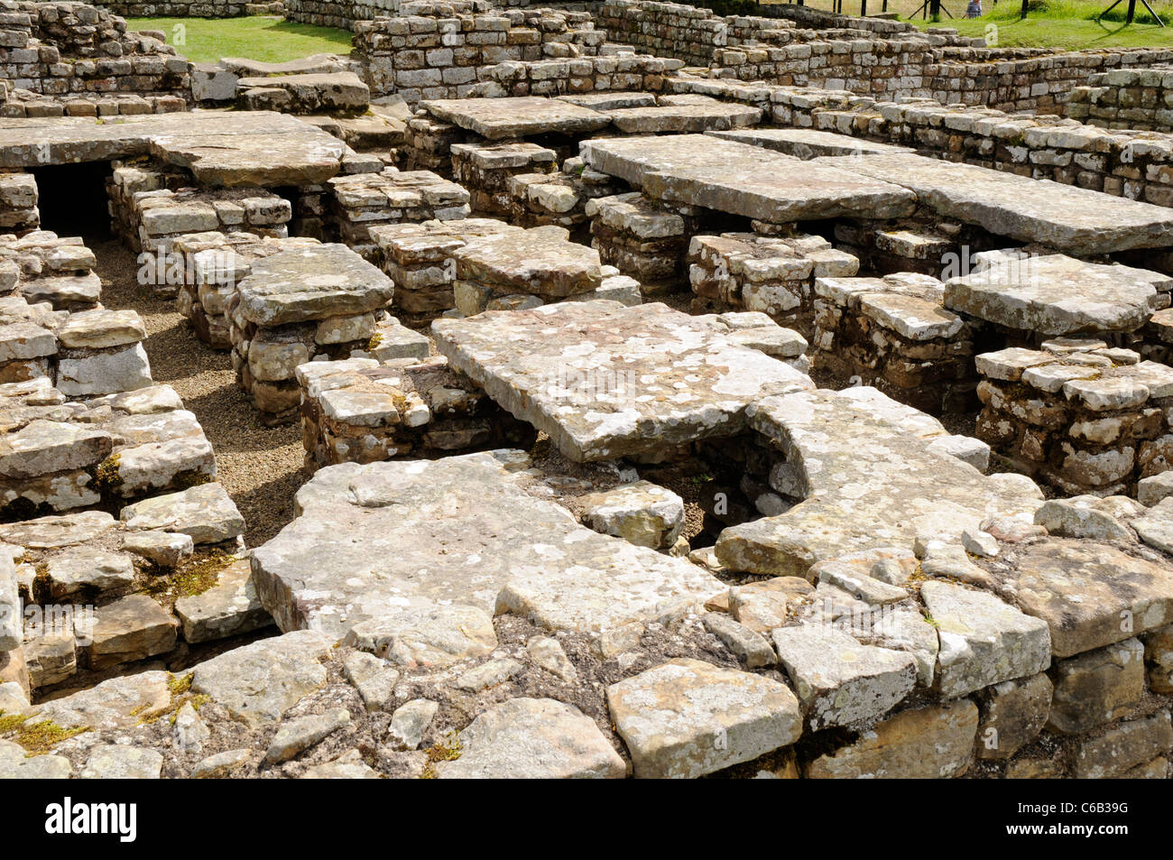 The praetorium or commanding officer's residence. Roman ruins at Chesters Fort, on Hadrian's Wall, England. - Stock Image