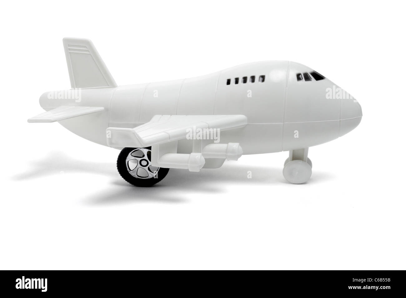 Plastic toy passenger jet plane on white background - Stock Image