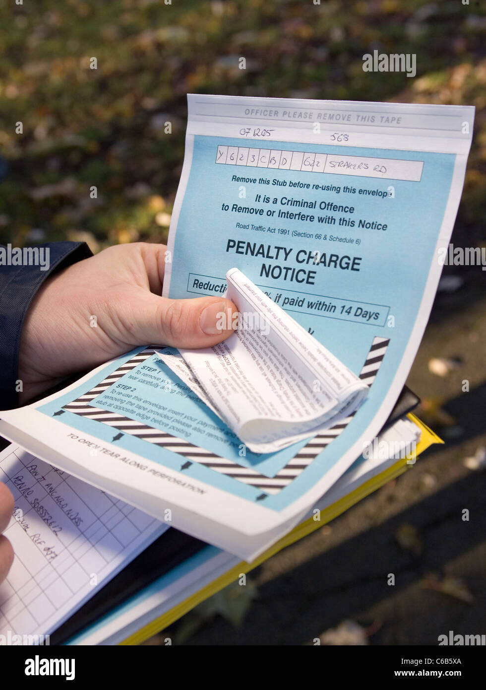 A penalty notice charge (Parking ticket) being issued to a car. London. UK - Stock Image
