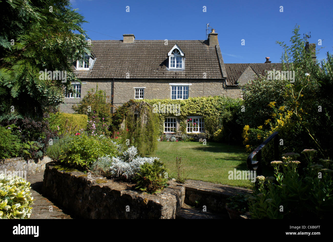 Country houses in the pretty village of Cranford St John, UK - Stock Image