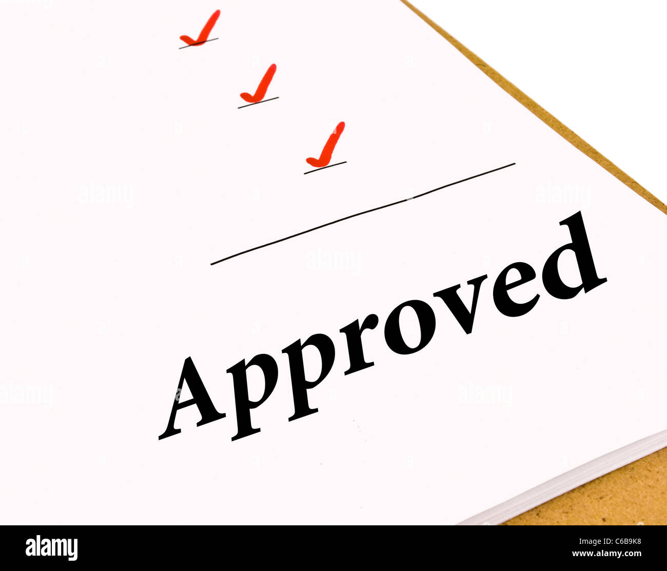 Approved status under a checklist isolated on white - Stock Image