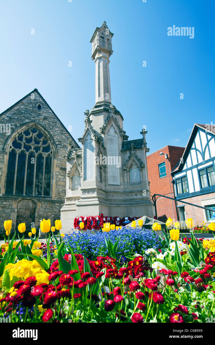Lincoln city war memorial on the high street. Flowers and poppies  to remember the dead - Stock Image