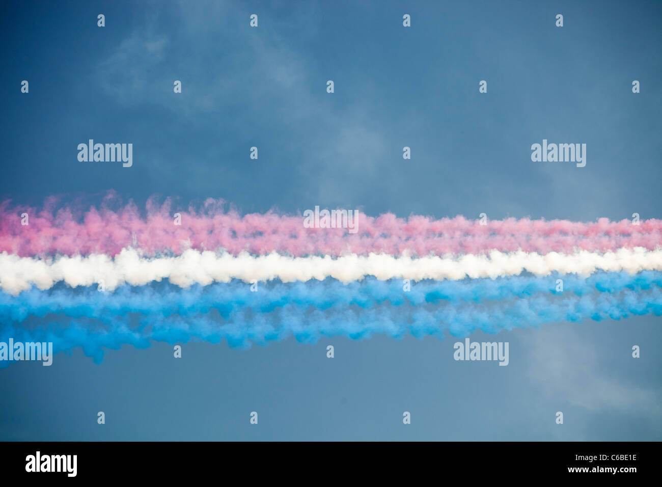 Contrails from the Red Arrows display team. - Stock Image