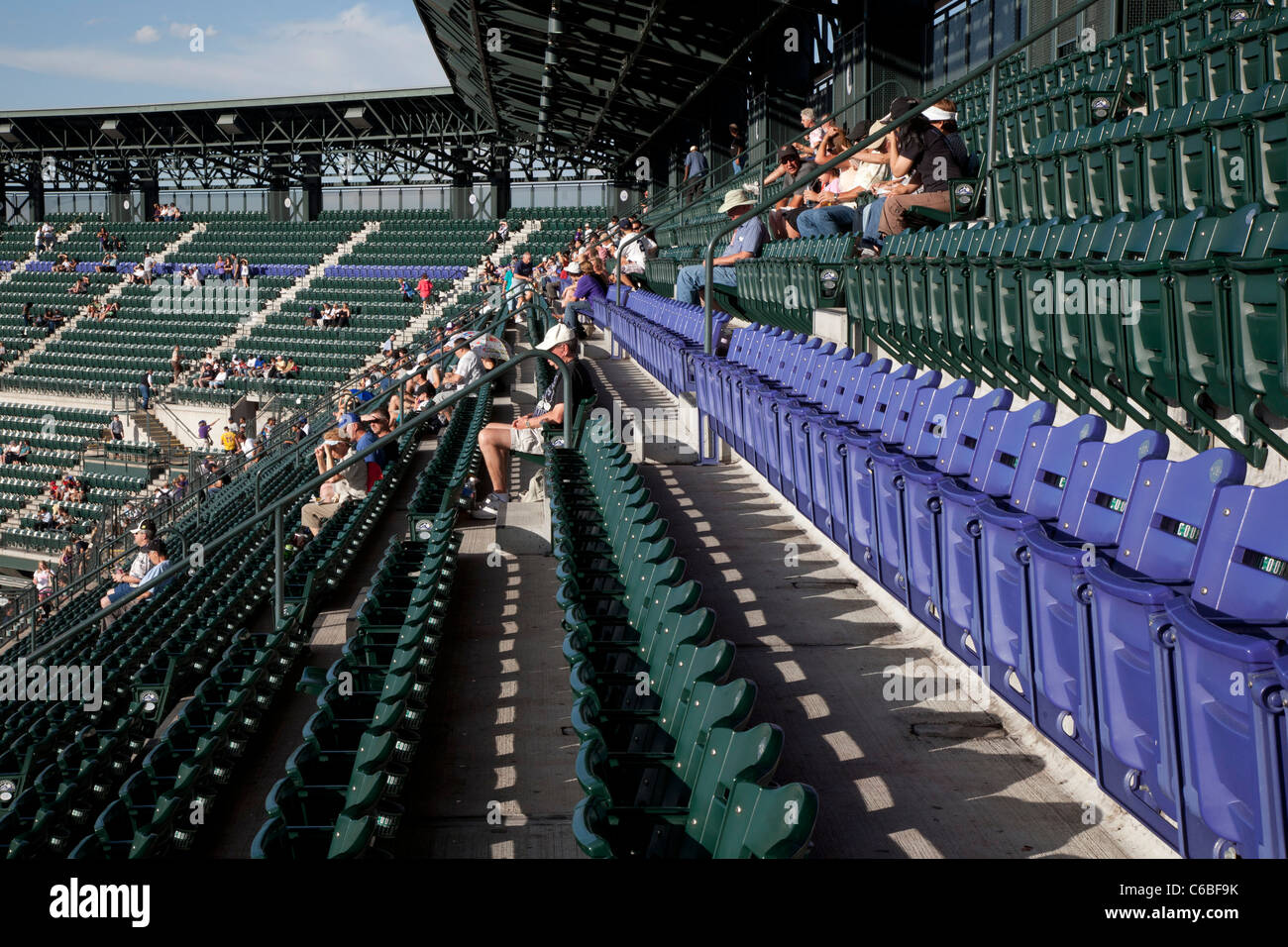 Denver, Colorado - A row of blue seats at Coors Field marks the city of Denver's mile-high elevation - Stock Image