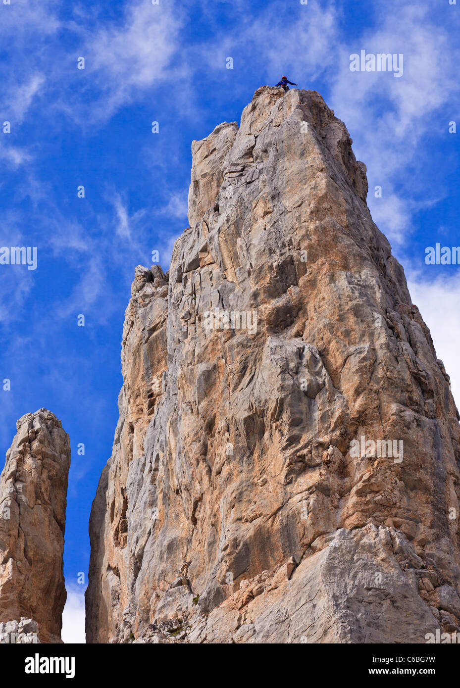 Climber on top of a limestone rock in Picos de Europa, Spain - Stock Image