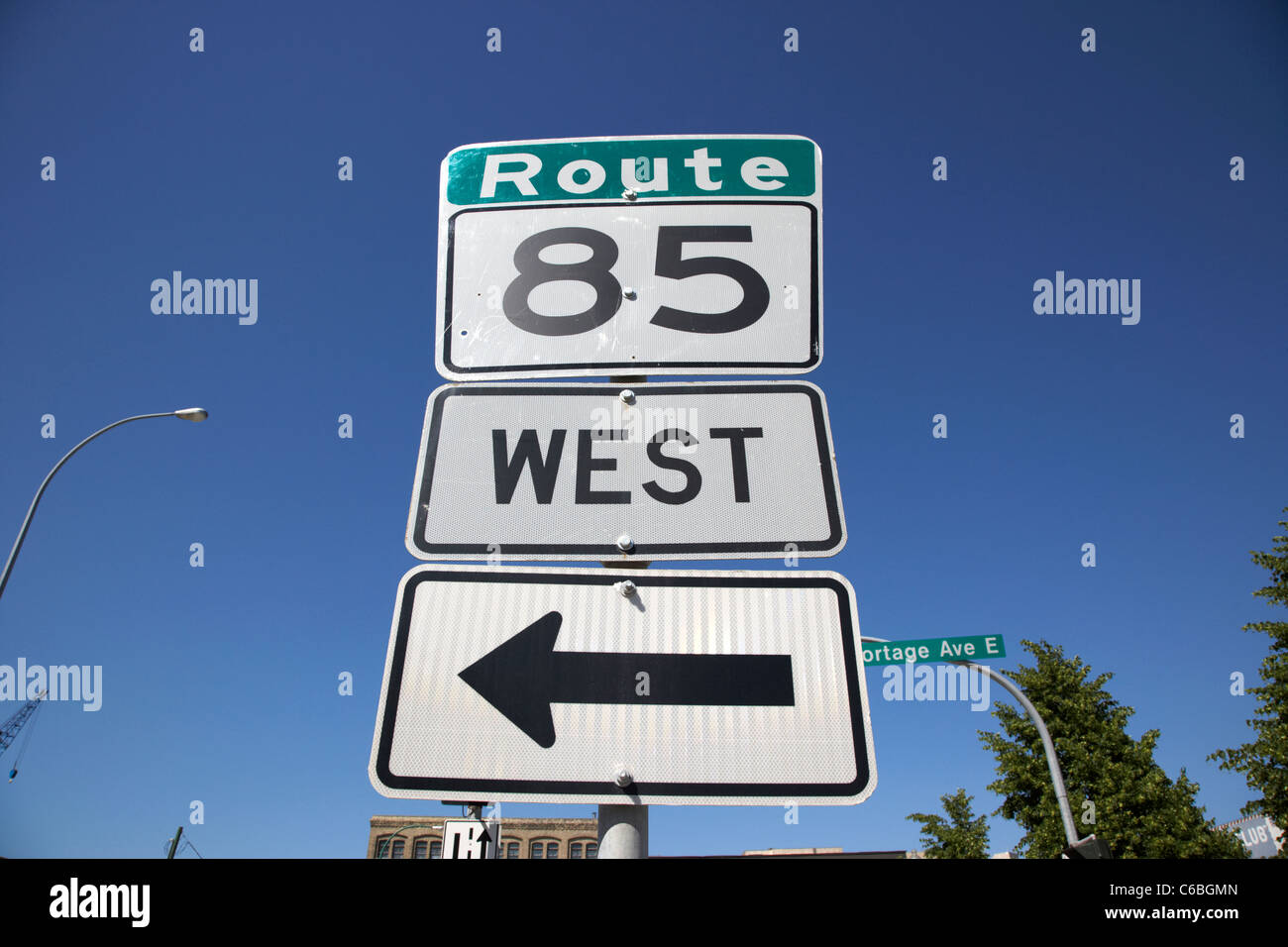 route 85 west arrow direction sign in downtown winnipeg manitoba canada - Stock Image