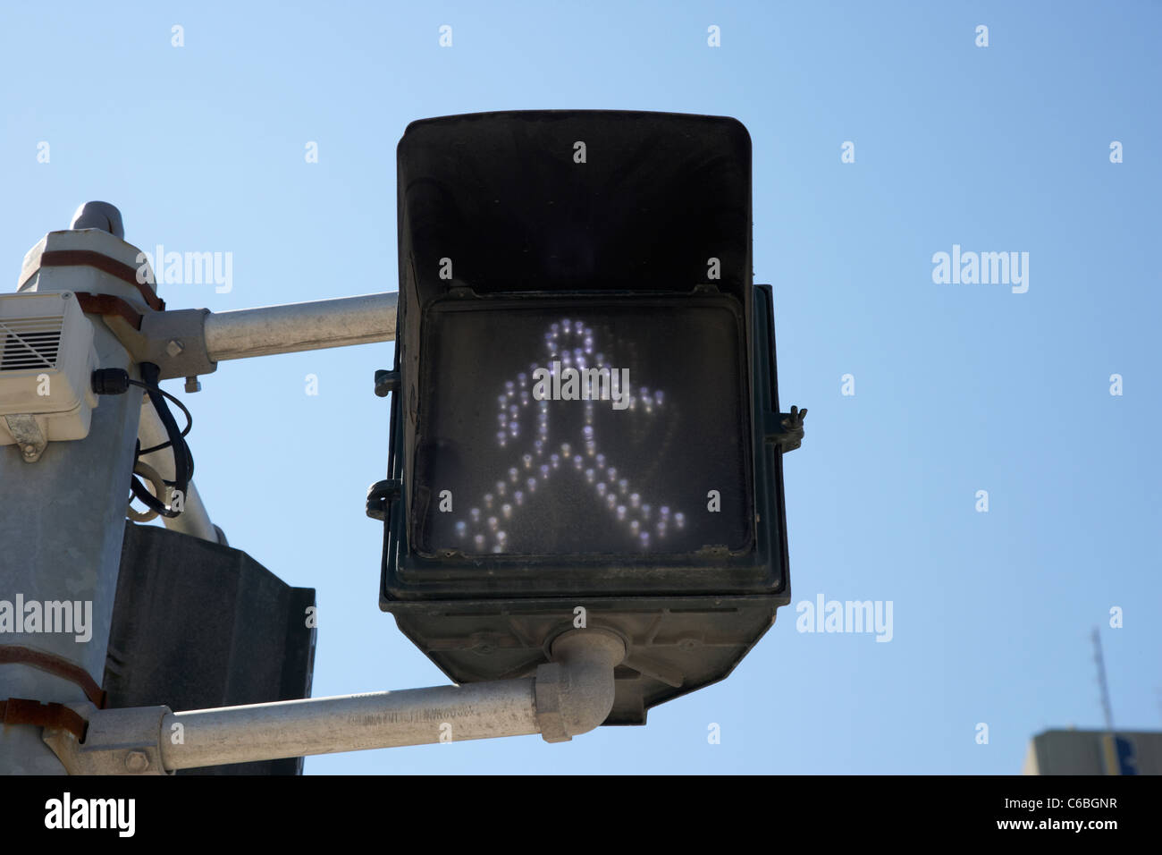 low energy led white man cross pedestrian crossing sign in downtown winnipeg manitoba canada - Stock Image