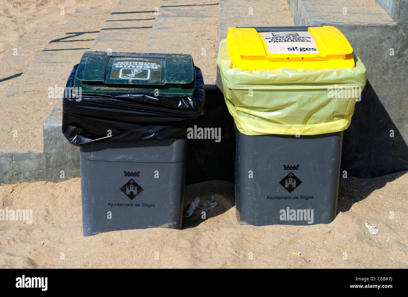 Two rubbish bins on a Spanish beach - Stock Image