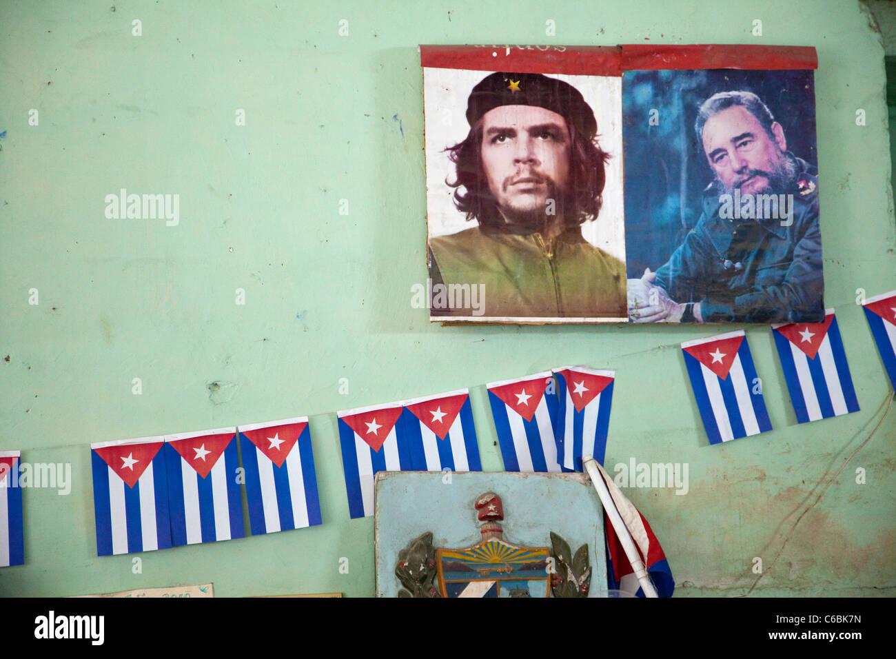 Cuba, Havana. Leaders of the Revolution, Che Guevara and Fidel Castro. Wall Decoration inside a Store. Stock Photo