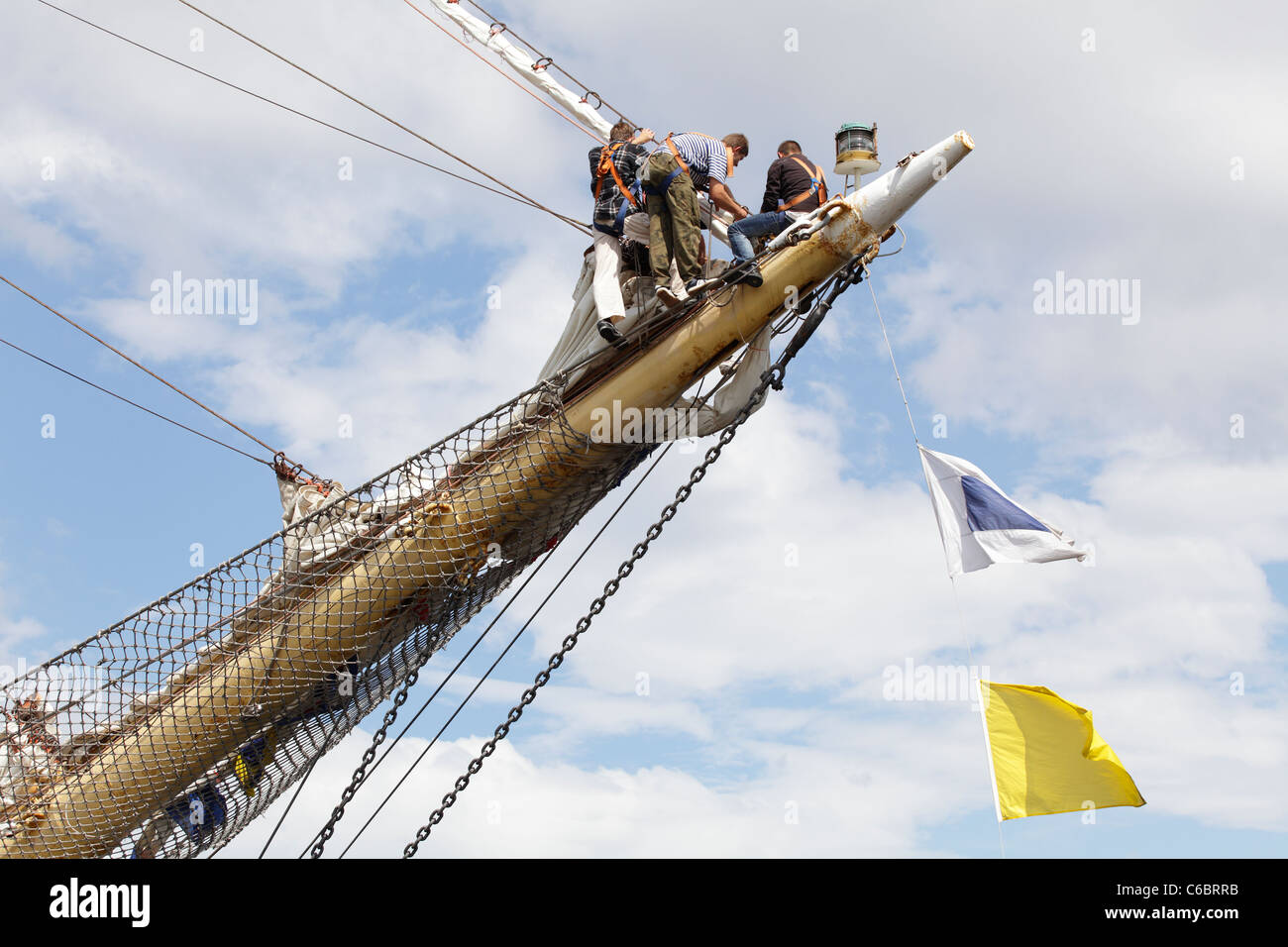 Crew working on a ship berthed at the Tall Ships Race 2011 in Greenock, Scotland, UK - Stock Image