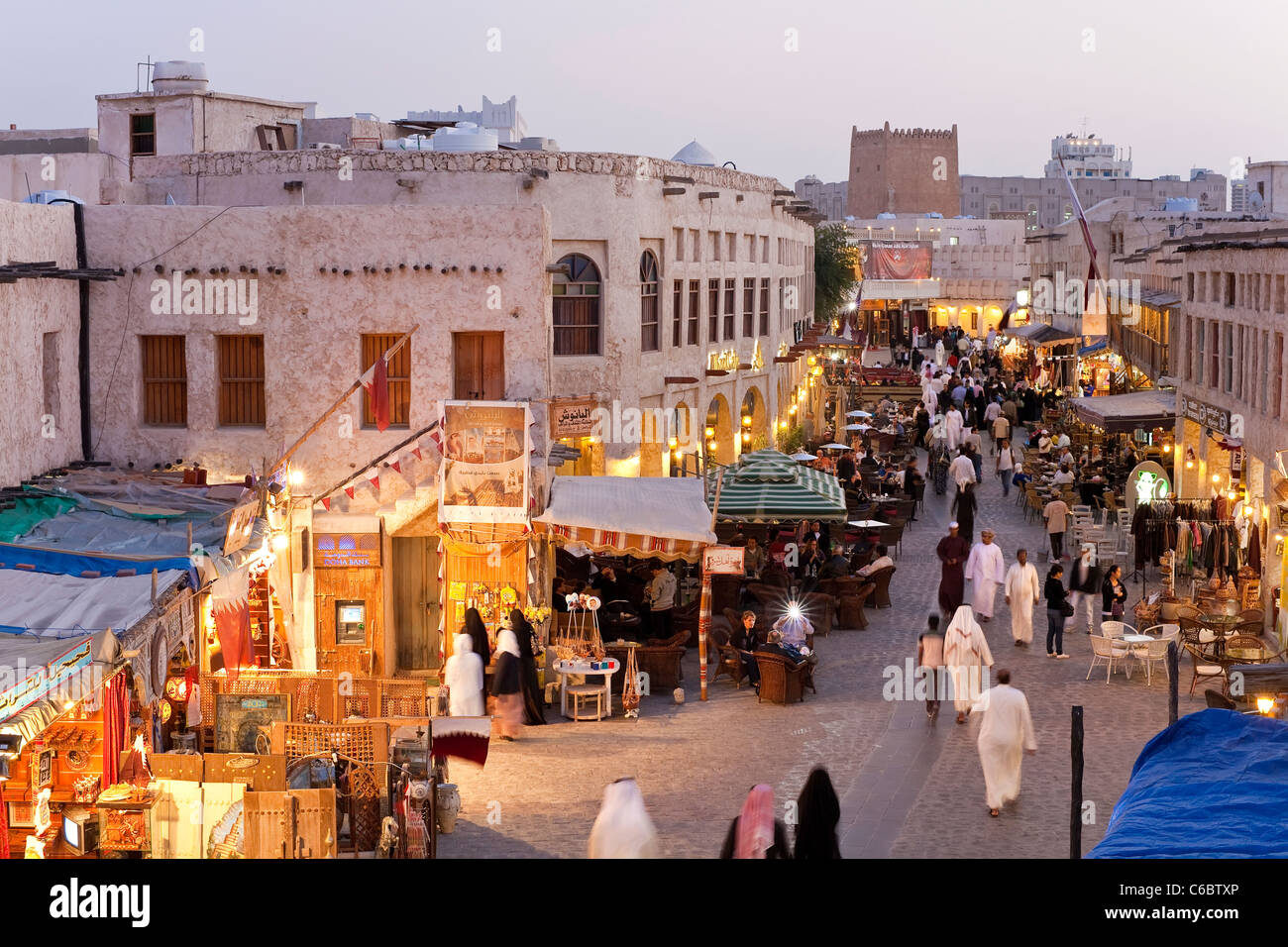 Qatar, Middle East, Arabian Peninsula, Doha, the restored Souq Waqif with mud rendered shops and exposed timber - Stock Image