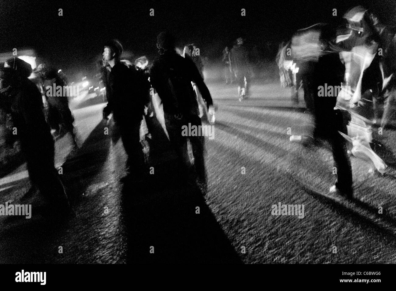 """Young people dance during the night at Czech Free Tekno Festival """"Czarotek"""" close to Květná, Czech Republic. Stock Photo"""