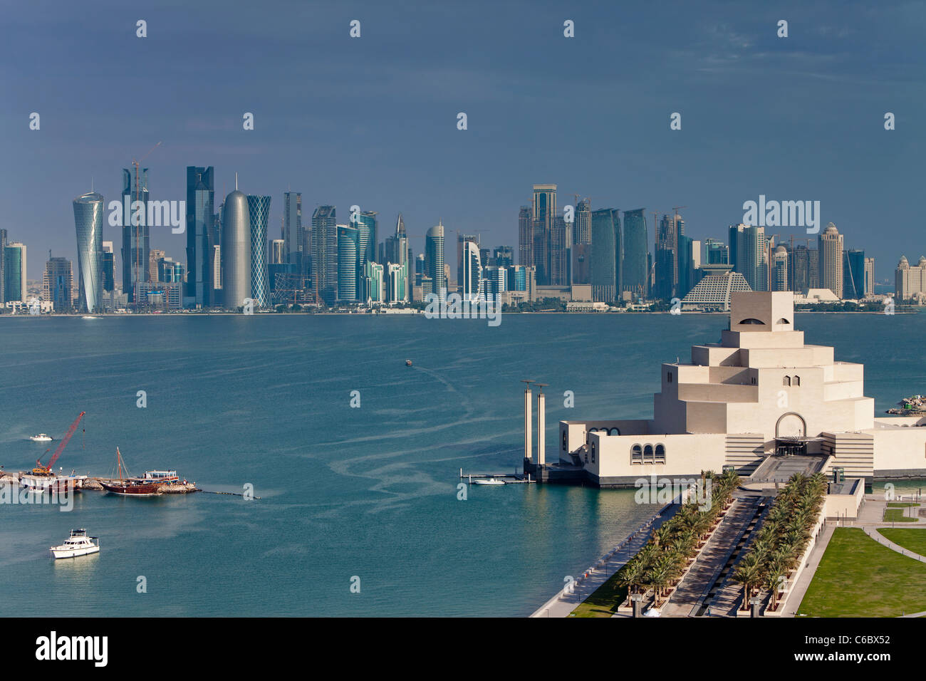 Qatar, Middle East, Arabian Peninsula, Doha, Elevated view over the Museum of Islamic Art and the Dhow harbour - Stock Image