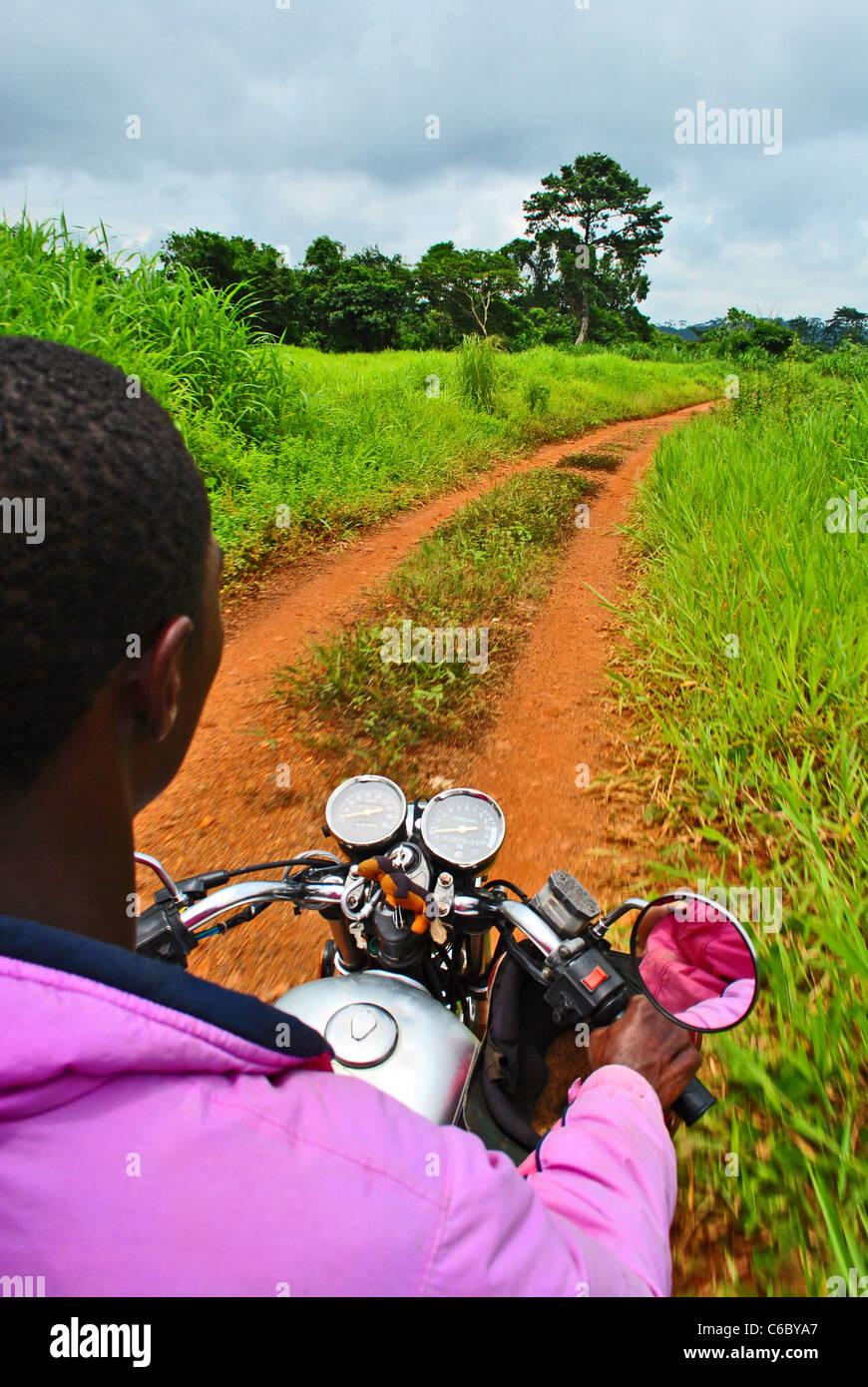 Motorbike taxi near Gbarnga, Liberia, West Africa - Stock Image