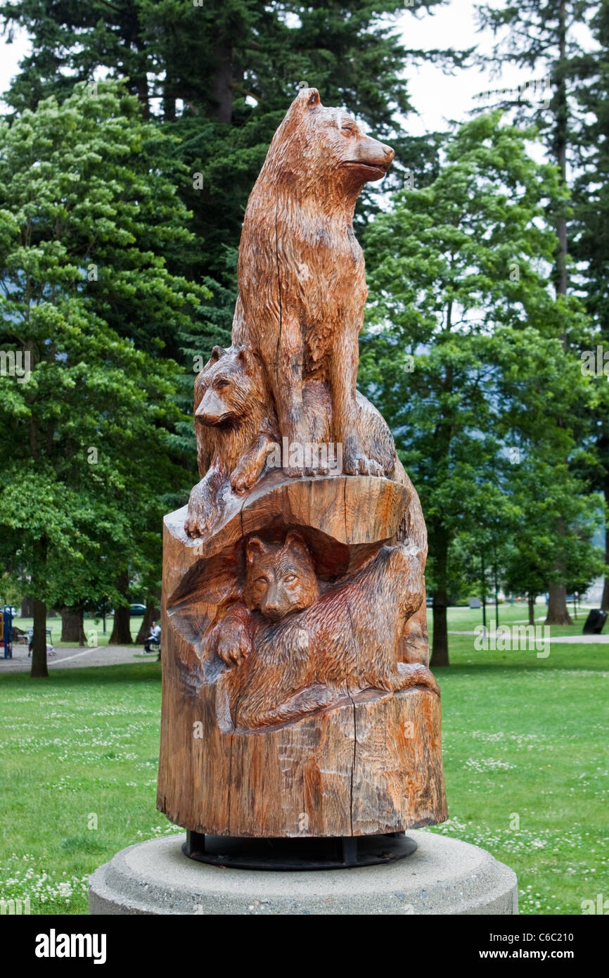 Wolf and cubs chainsaw wood carving in hope canada stock photo