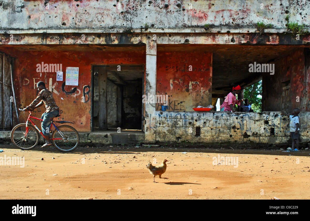 Bullet holes in a house in Zorzor, Liberia - Stock Image