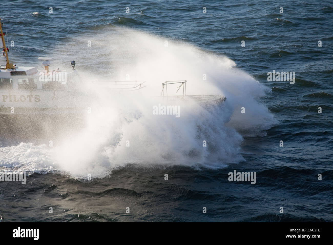 Pilot boat fighting the wawes Stock Photo