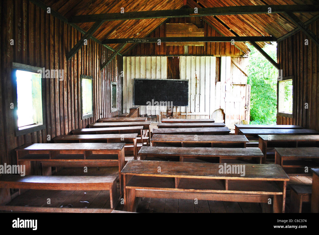 Empty classroom in a converted church, Bolahun, Liberia - Stock Image