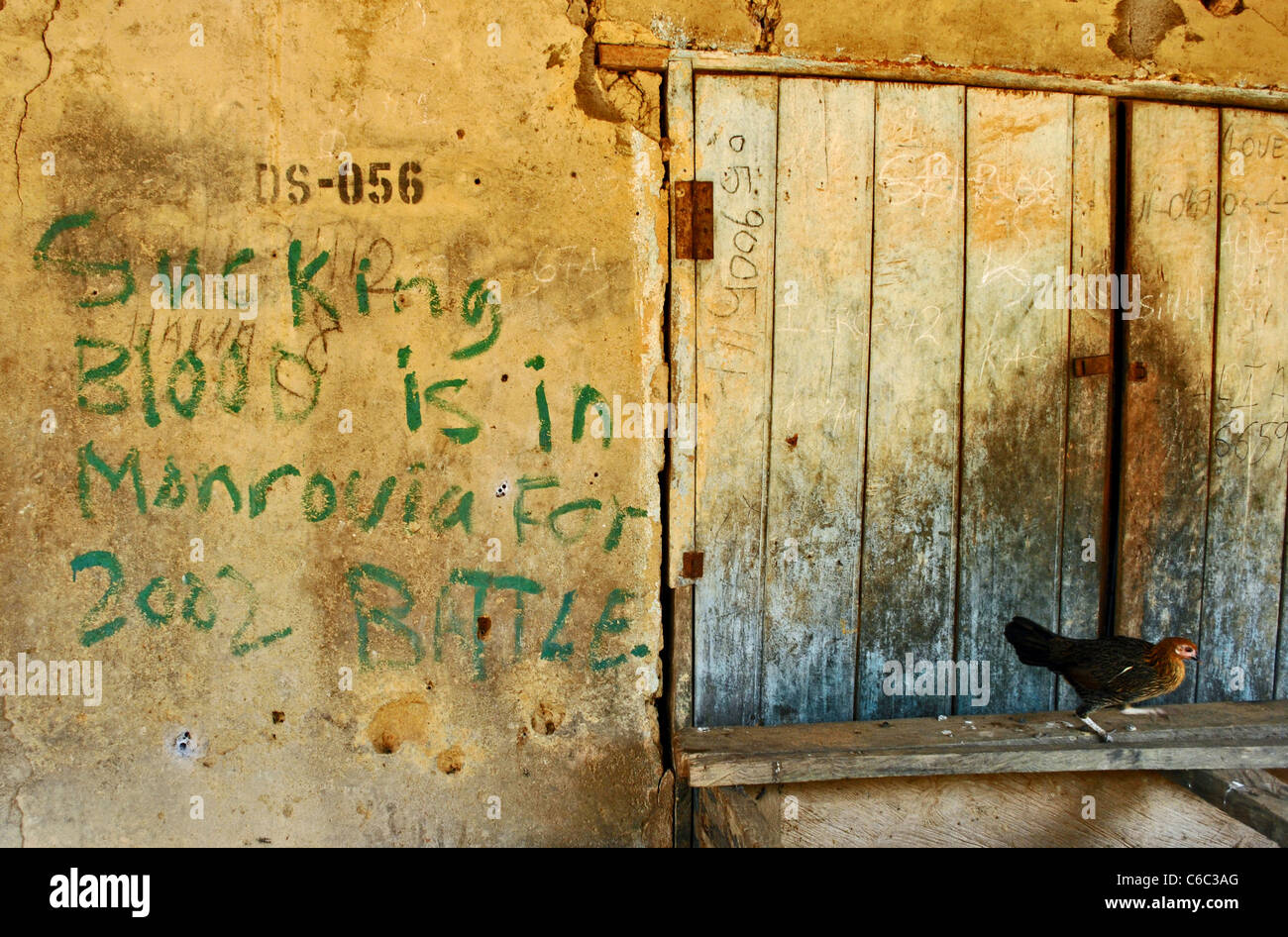 Graffiti left by LURD rebels on a wall in Bolahun, Liberia - Stock Image