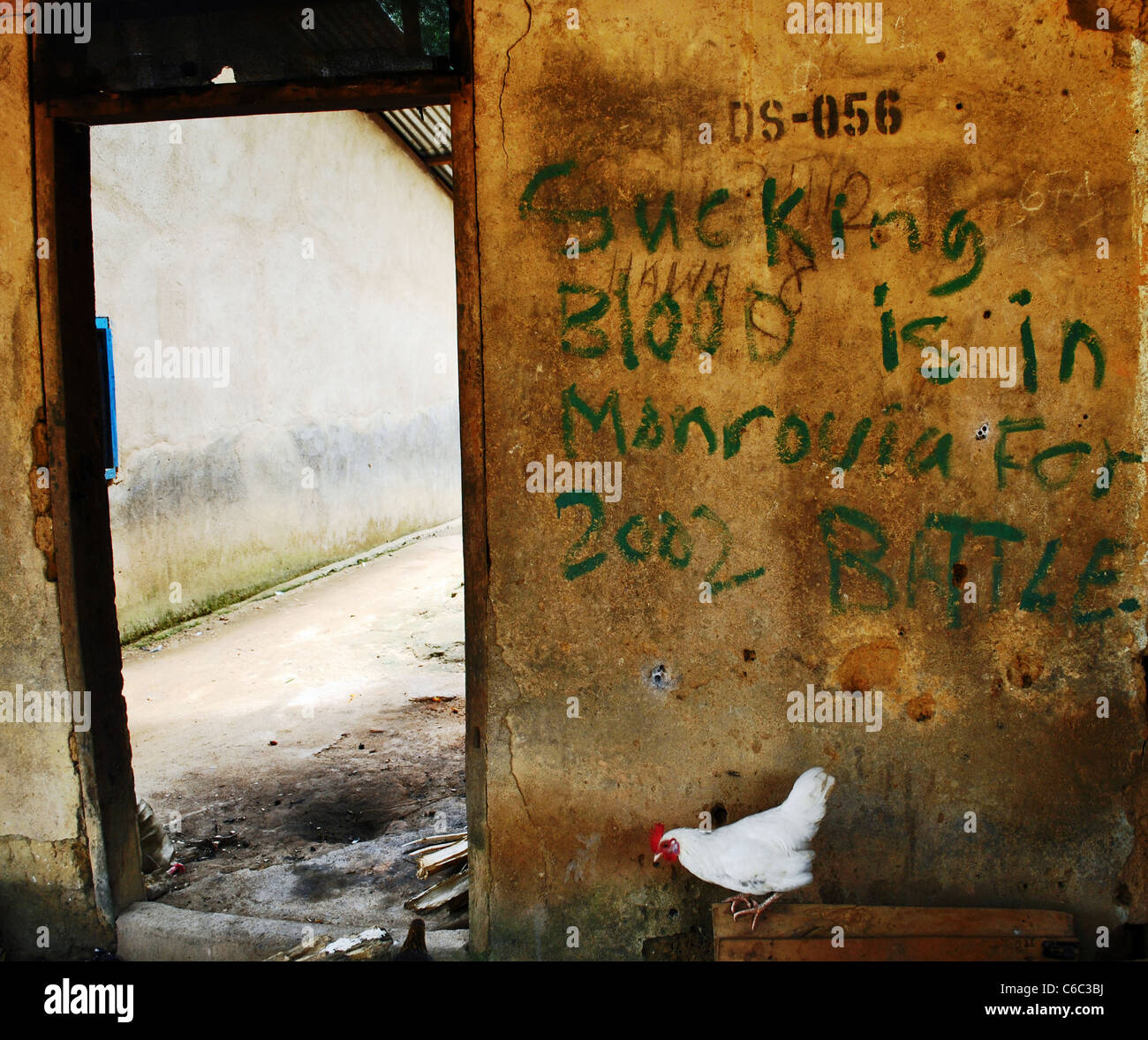 Graffiti - SUCKING BLOOD IS IN MONROVIA FOR 2002 BATTLE - left by LURD rebels on a wall in Bolahun, Liberia - Stock Image