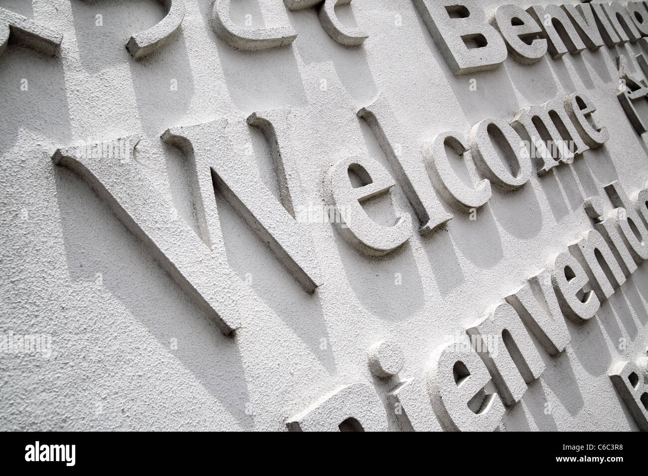 Welcome board with greeting on foreign languages - Stock Image