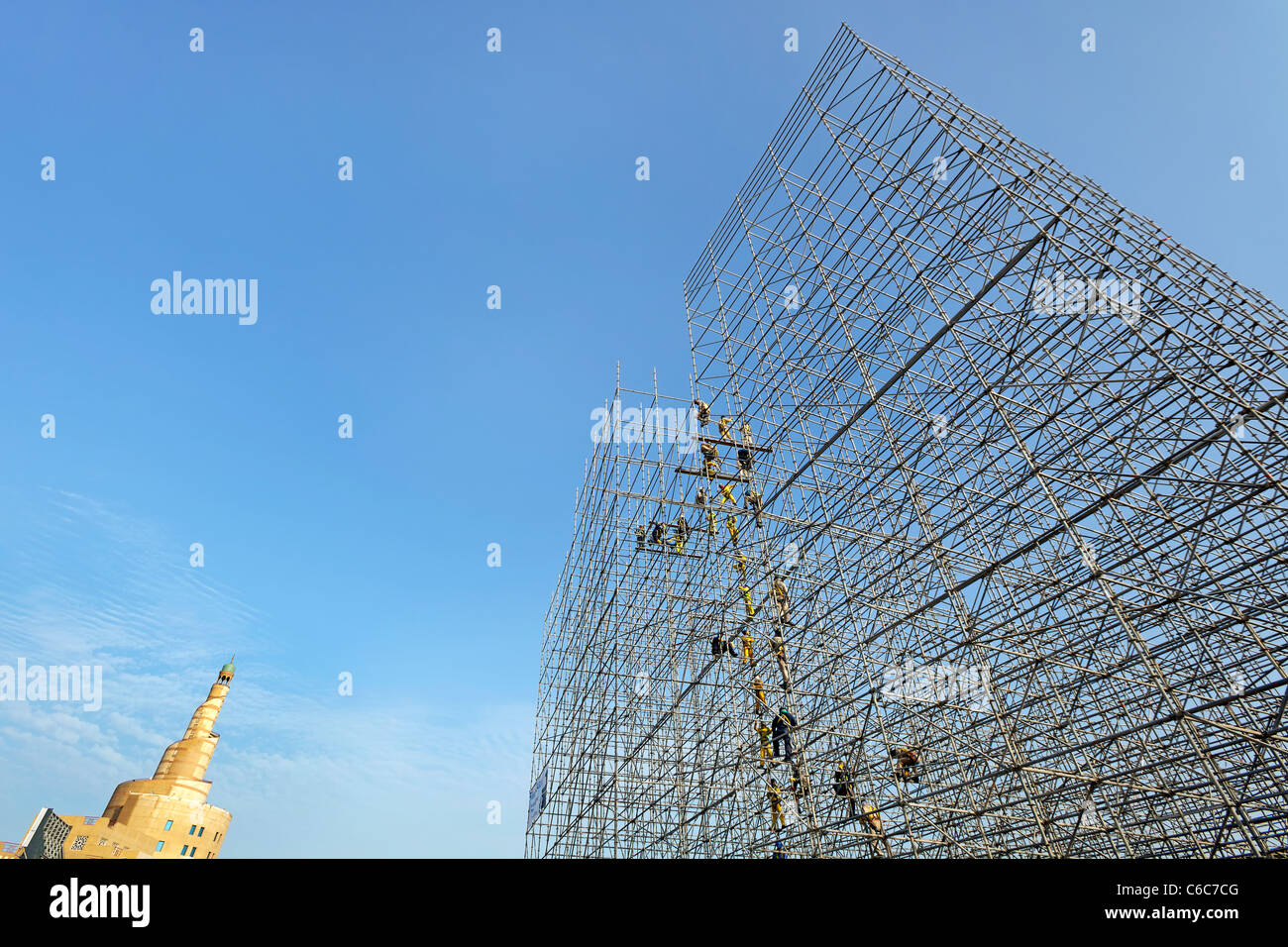 Qatar, Middle East, Arabian Peninsula, Doha, Scaffolding construction being erected in Central Doha - Stock Image