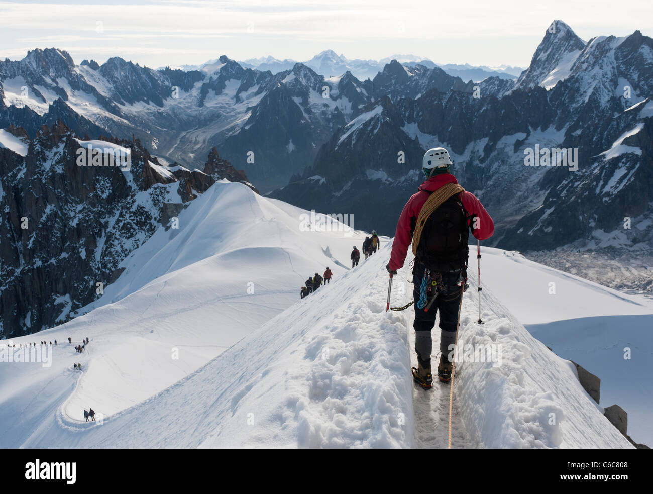 Climbers walking down the airy ridge of Aiguille du Midi at Chamonix, France Stock Photo