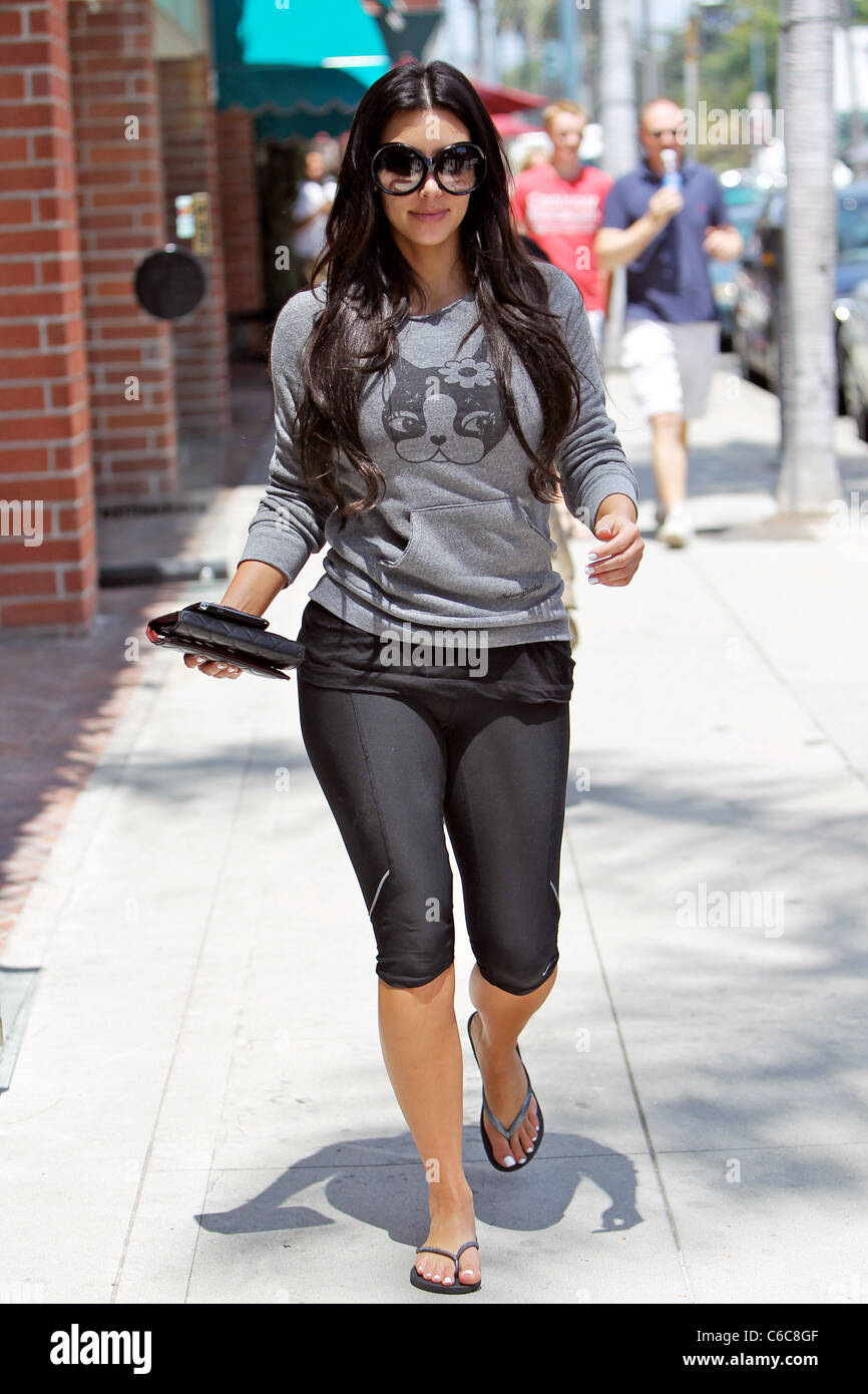 Kim Kardashian departs a nail salon after having her nails painted ...