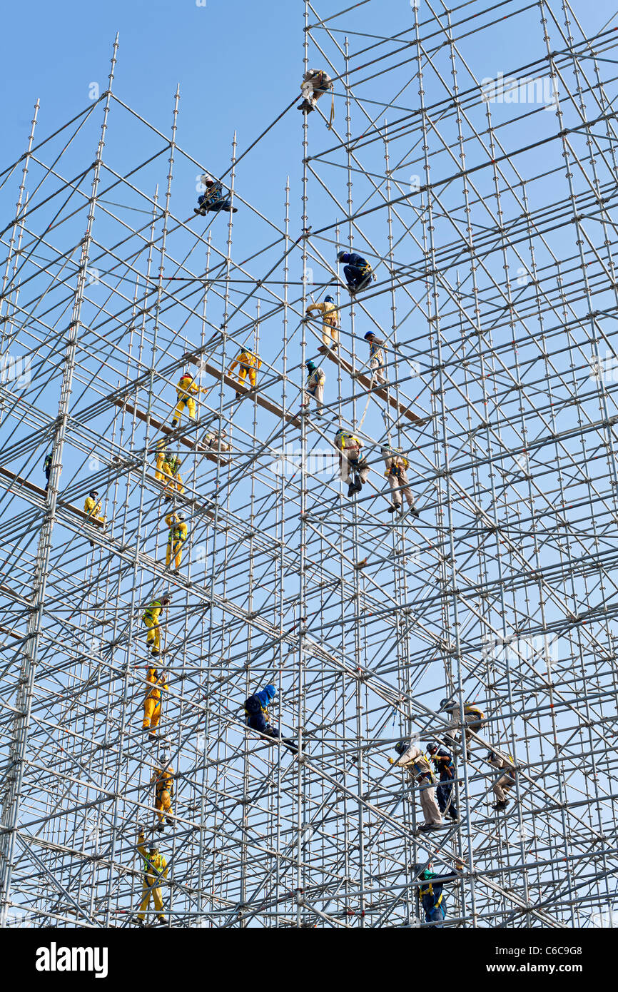 Qatar, Middle East, Arabian Peninsula, Doha, Scaffolding construction being erected in Central Doha Stock Photo