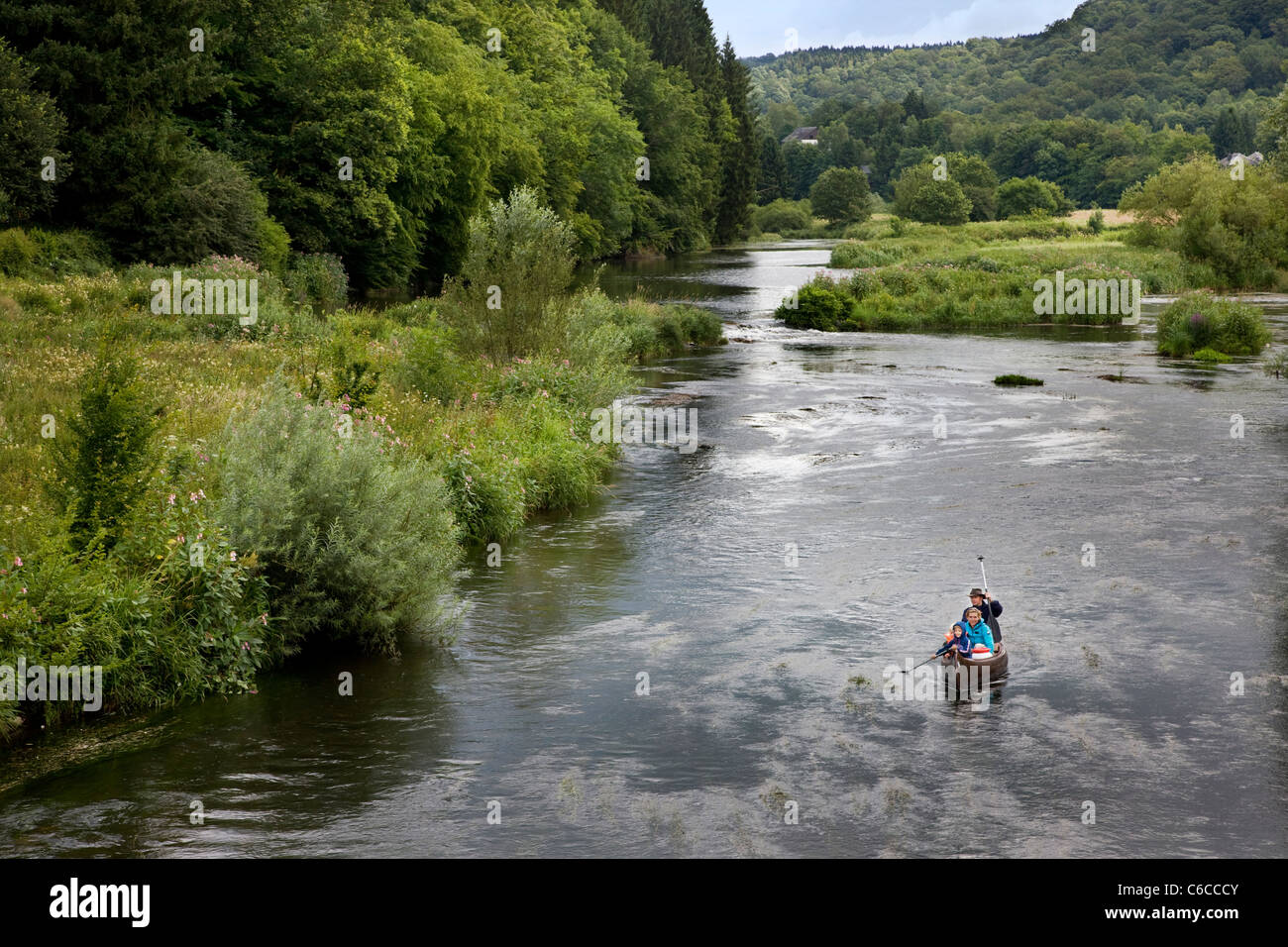 Tourists paddling in canoe on the river Semois in the Belgian Ardennes, Belgium - Stock Image