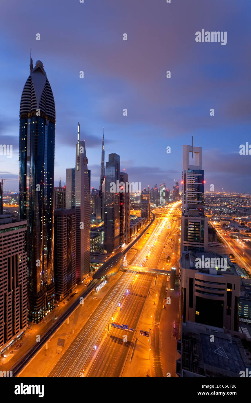 Elevated view over the modern Skyscrapers along Sheikh Zayed Road looking towards the Burj Kalifa, Dubai, United Stock Photo