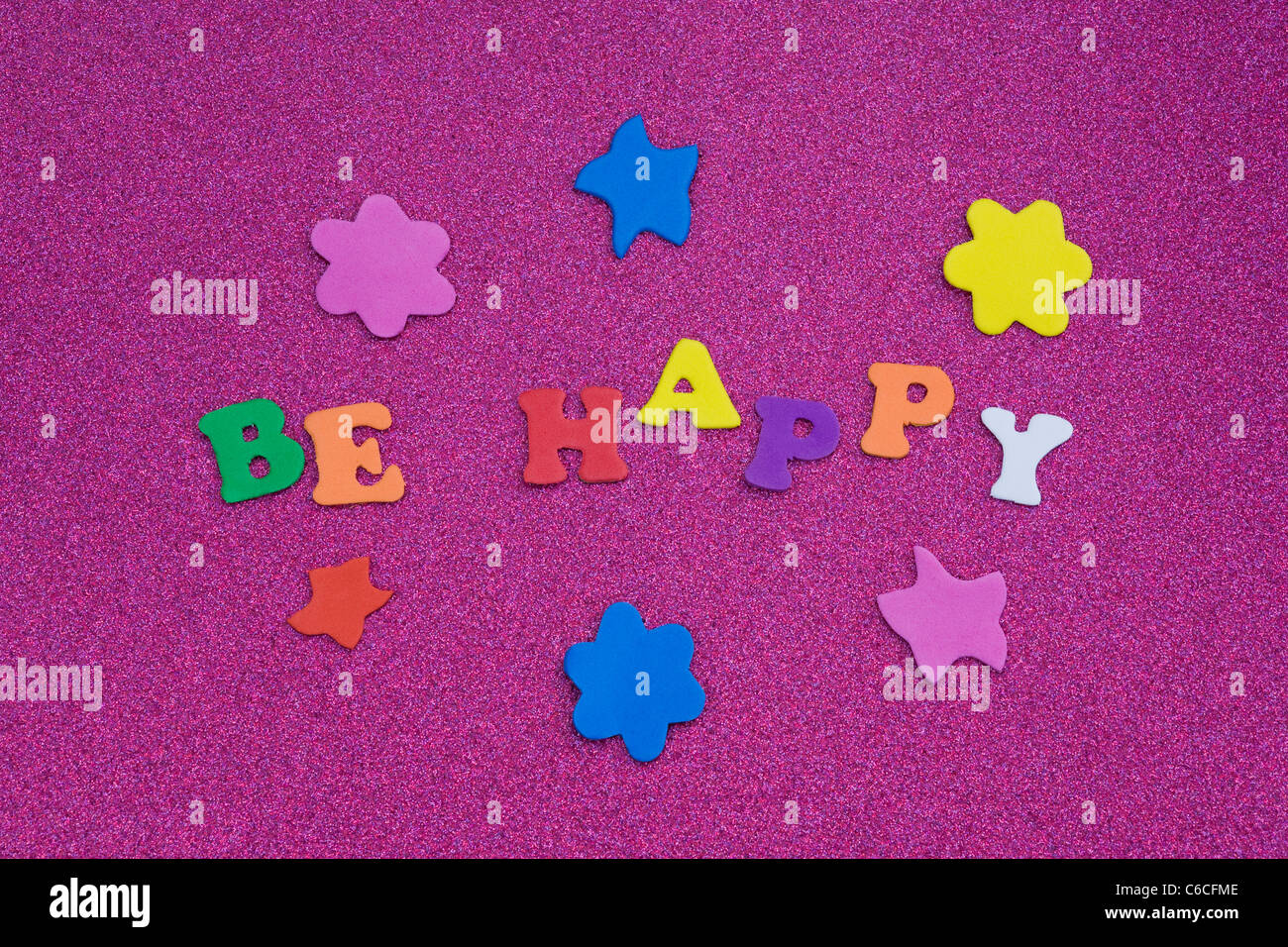 The words 'Be Happy' on a purple background. - Stock Image