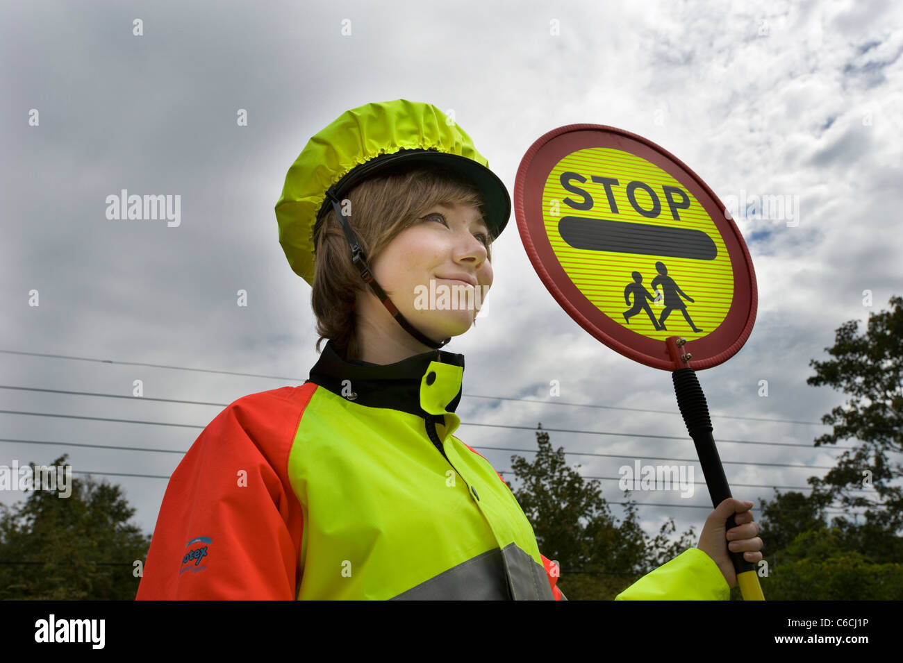 Cornwall's youngest lollipop lady in 2011, 18 year old Tomasina on school crossing patrol. Stock Photo