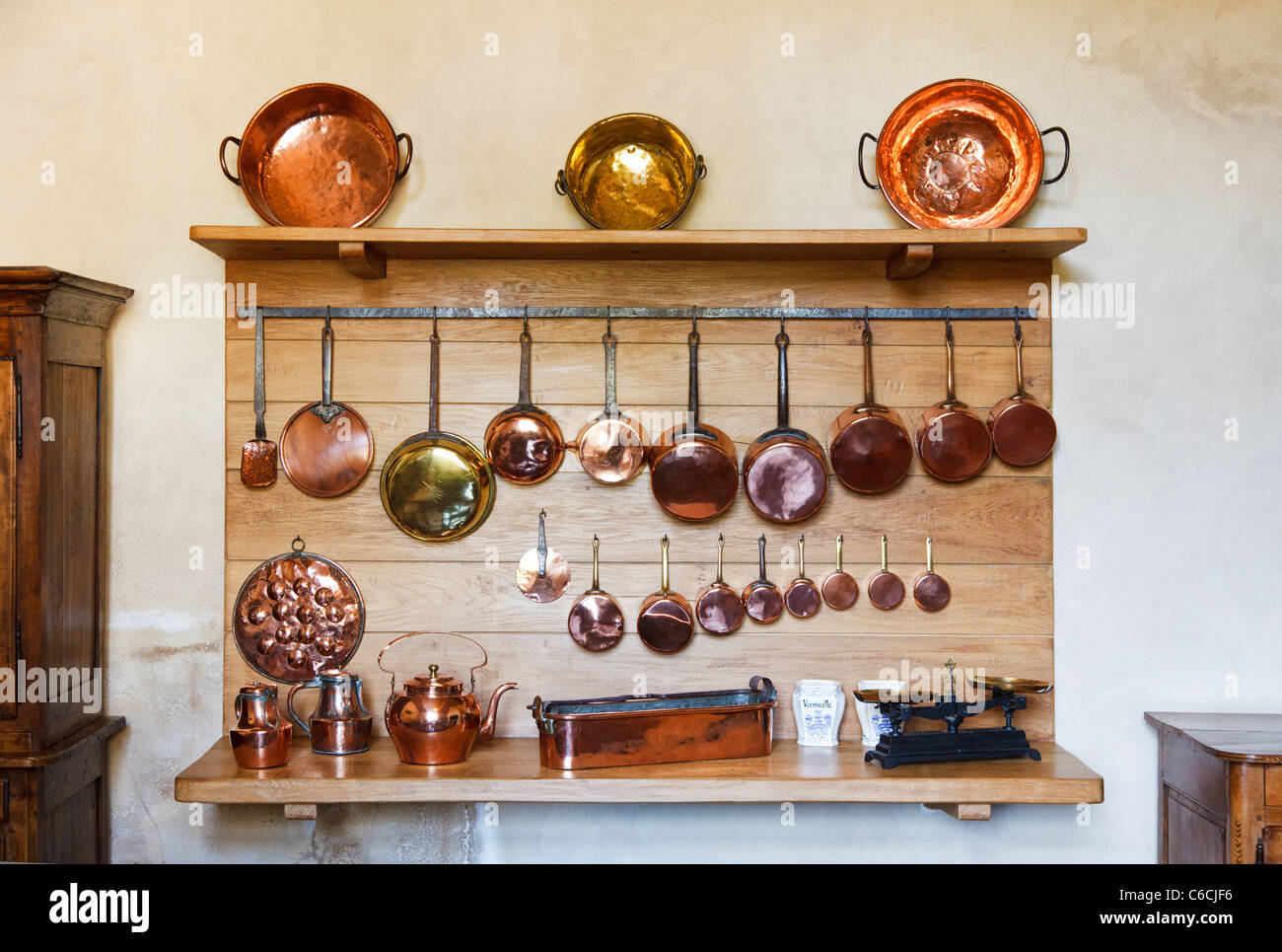 Copper pots and pans in a kitchen - Stock Image