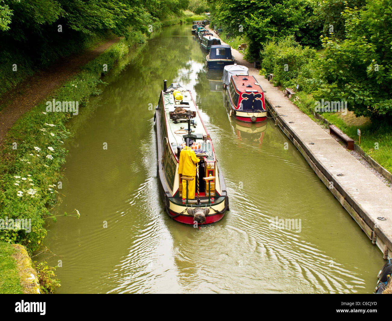 A canal scene with narrowboats near Pewsey Wharf on the Kennet and Avon Canal in Wiltshire, England, UK - Stock Image