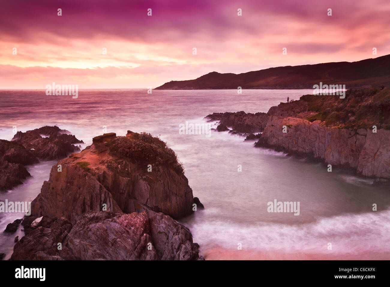 Sunset over the Bristol Channel from Barricane Beach, Woolacombe,looking towards Morte Point, North Devon, England, - Stock Image